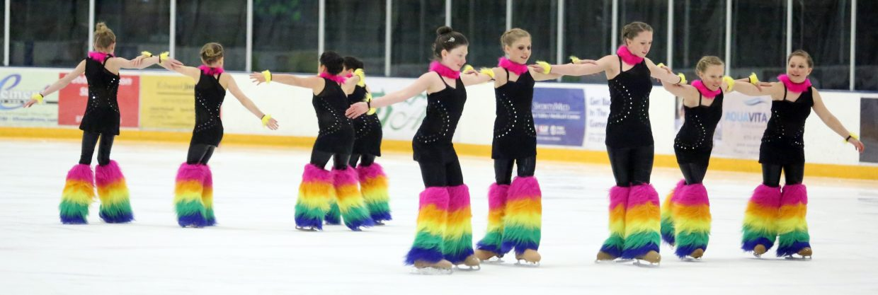"The ""Rainbow Sharks"" perform to ""Car Wash"" from the ""Shark Tales"" soundtrack during Sunday's annual Steamboat Springs Figure Skating Club spring ice show at Howelsen Ice Arena."