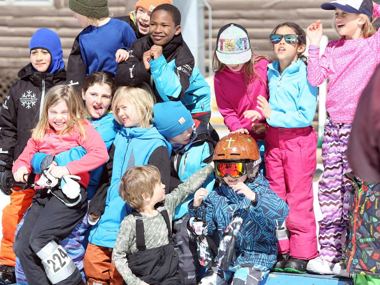 Children congregate around the podium for a picture before awards Sunday at the third annual Slash and Burn Banked Slalom at Howelsen Hill.