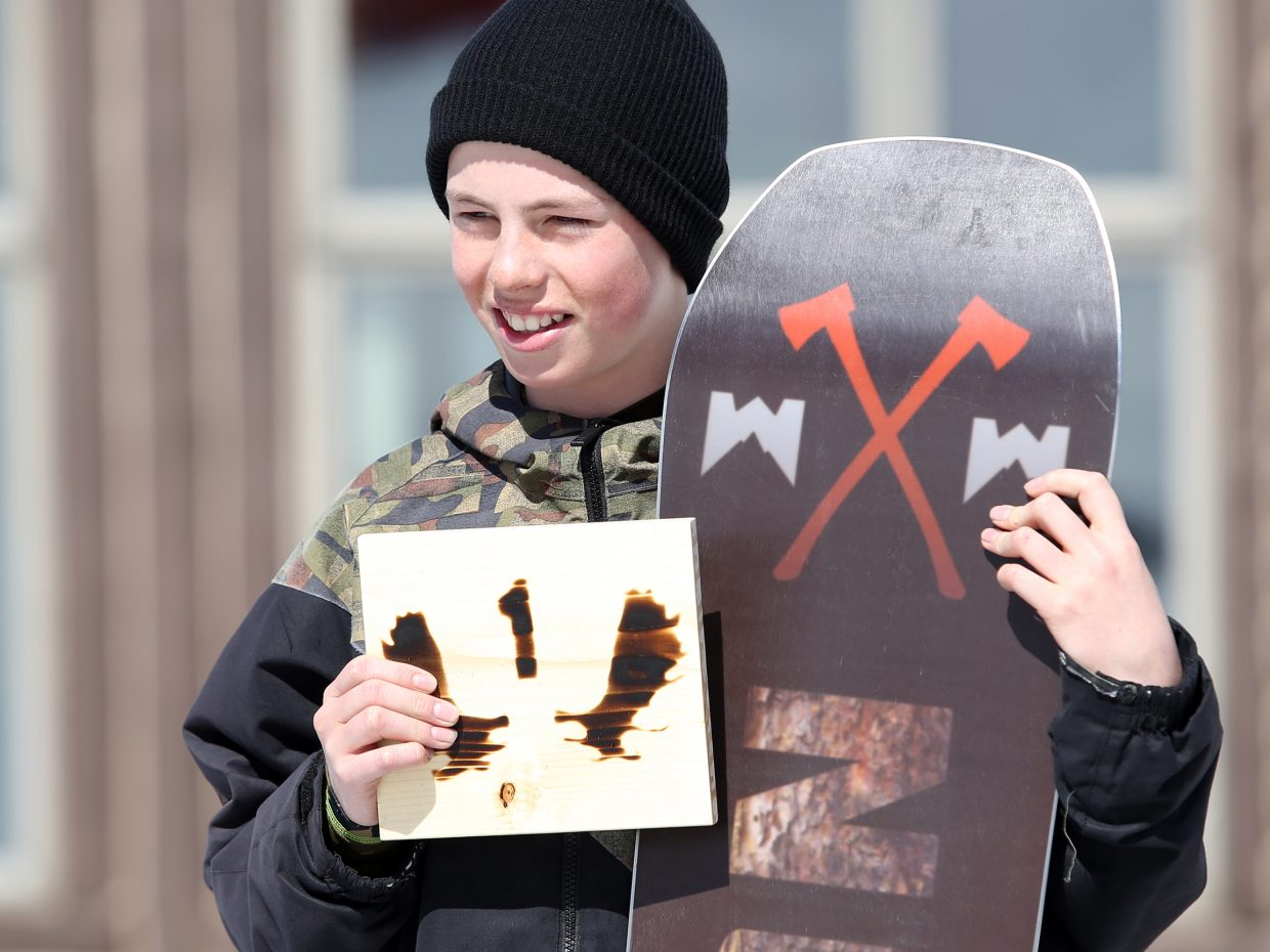 Steamboat's Winston Vaughan receives his awards — including a new snowboard — for winning the boys' teen classification of Sunday's Slash and Burn Banked Slalom at Howelsen Hill.
