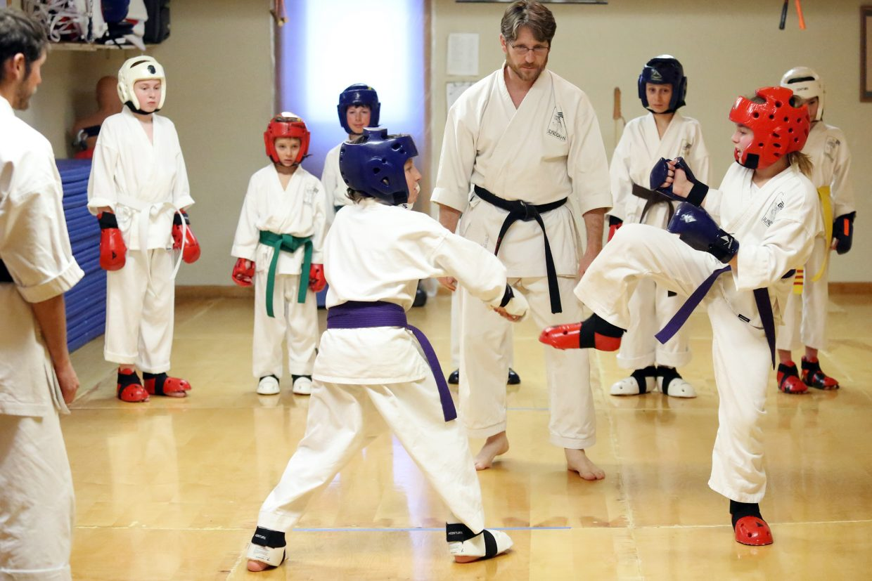 Sensei Michael David Bauk, center, leads a sparring session last week at his dojo, Rocky Mountain Karate Academy, in Steamboat Springs. This week, the school is sending nine of its members to the United States Karate Alliance national championships in Denver.