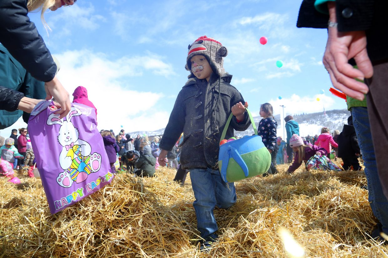 Steamboat Springs resident Maddox Kaleikini, 4, strolls through the hay in search of Easter eggs Saturday during the annual Easter Eggstravaganza at the Steamboat Springs Middle School.