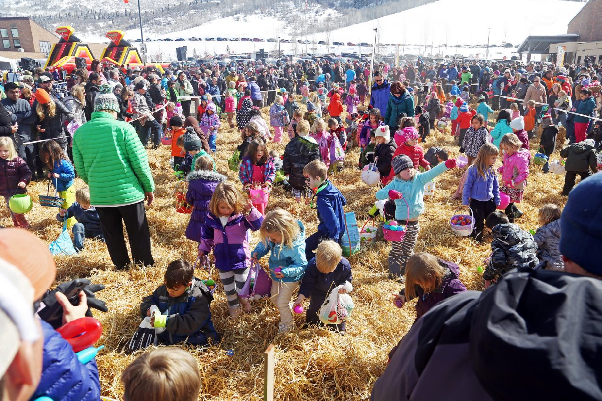 Chaos reigns as children search through the hay for eggs Saturday during the annual Easter Eggstravaganza at the Steamboat Springs Middle School.