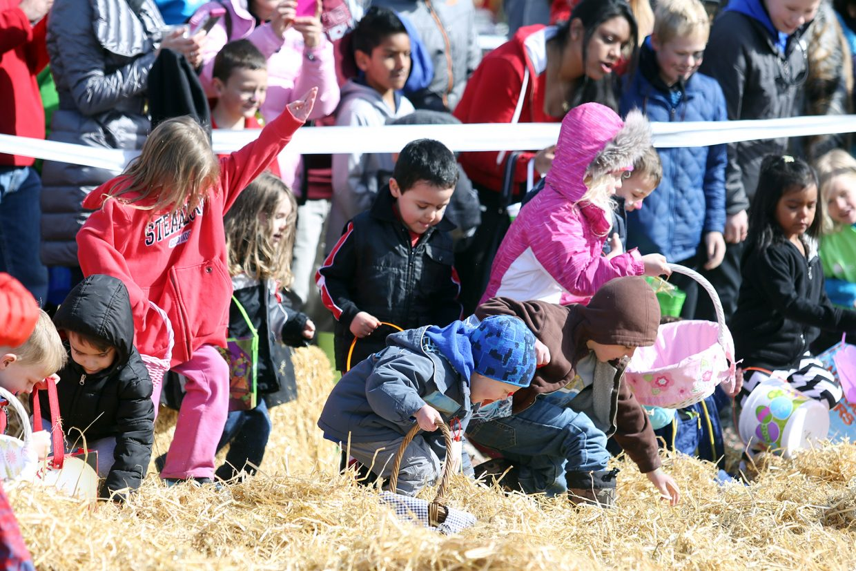 Children begin the hunt for Easter eggs Saturday during the annual Easter Eggstravaganza at the Steamboat Springs Middle School.