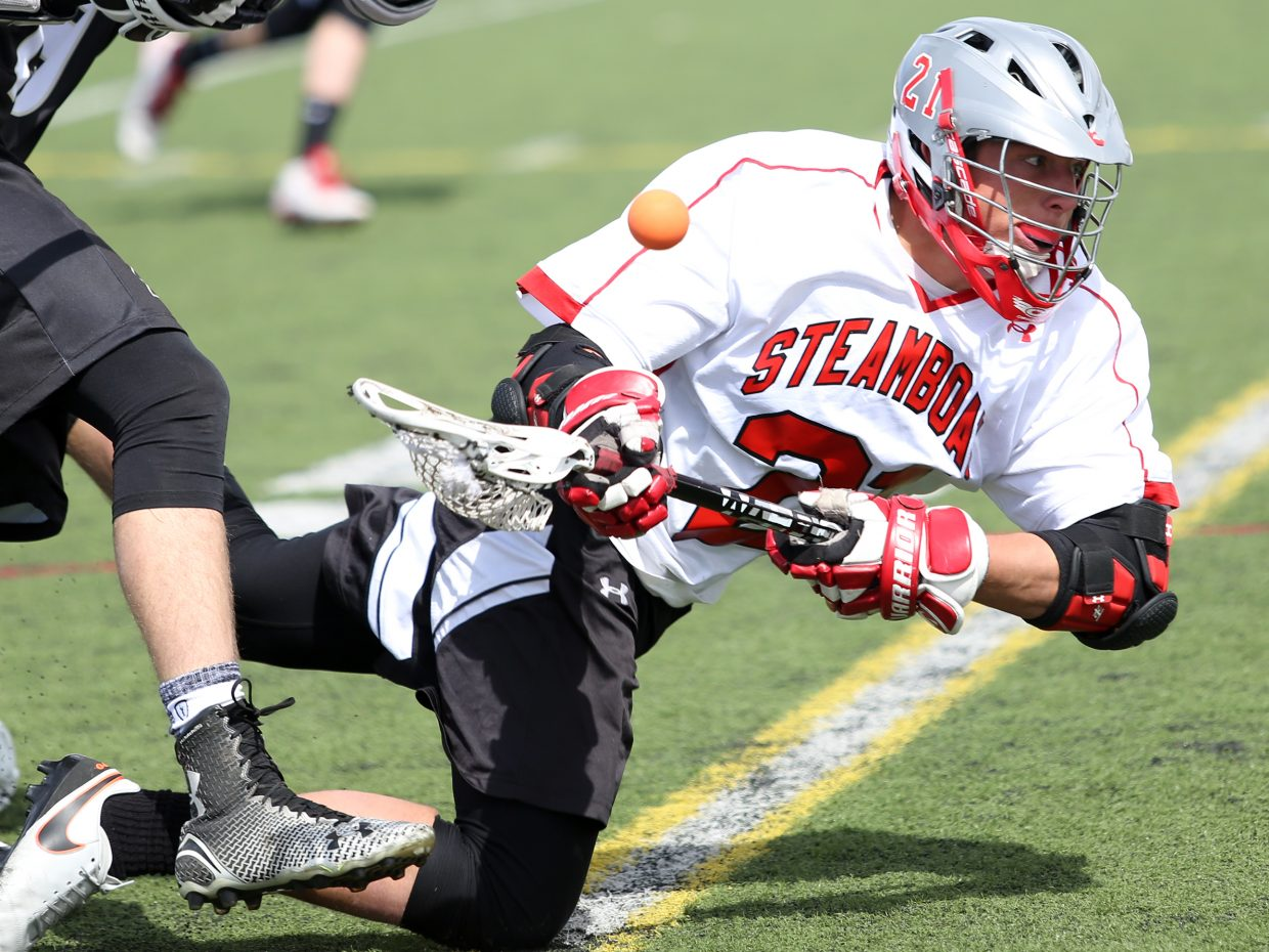 Steamboat Springs High School senior Joe DeLine loses possession of the ball after he was knocked to the ground Saturday against visiting Battle Mountain at Gardner Field. The Huskies pulled the upset, winning 11-10 in overtime.