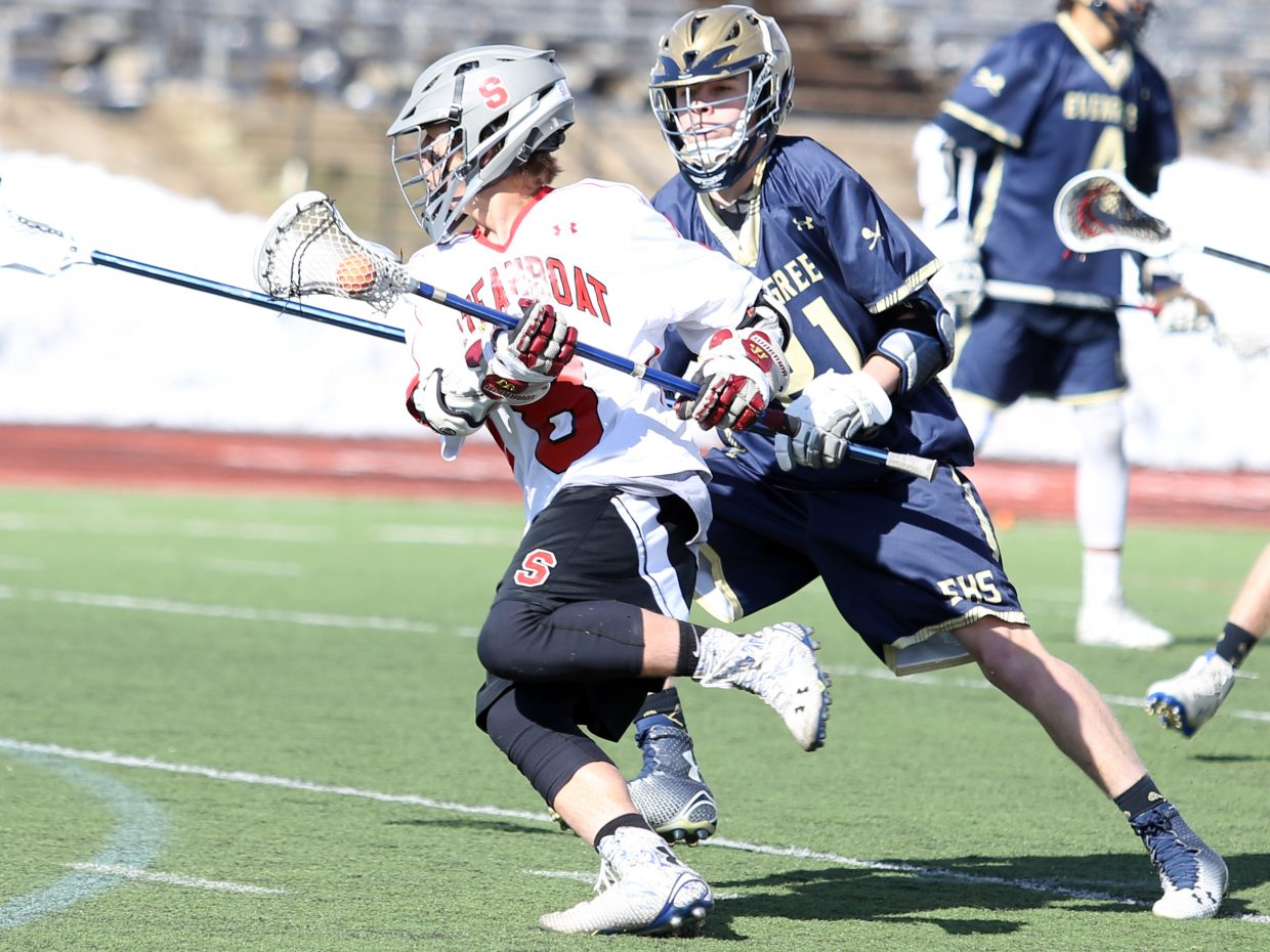 Steamboat Springs sophomore Davis Petersen attempts to evade his defender on Friday against Evergreen at Gardner Field. The Sailors won, 19-10.