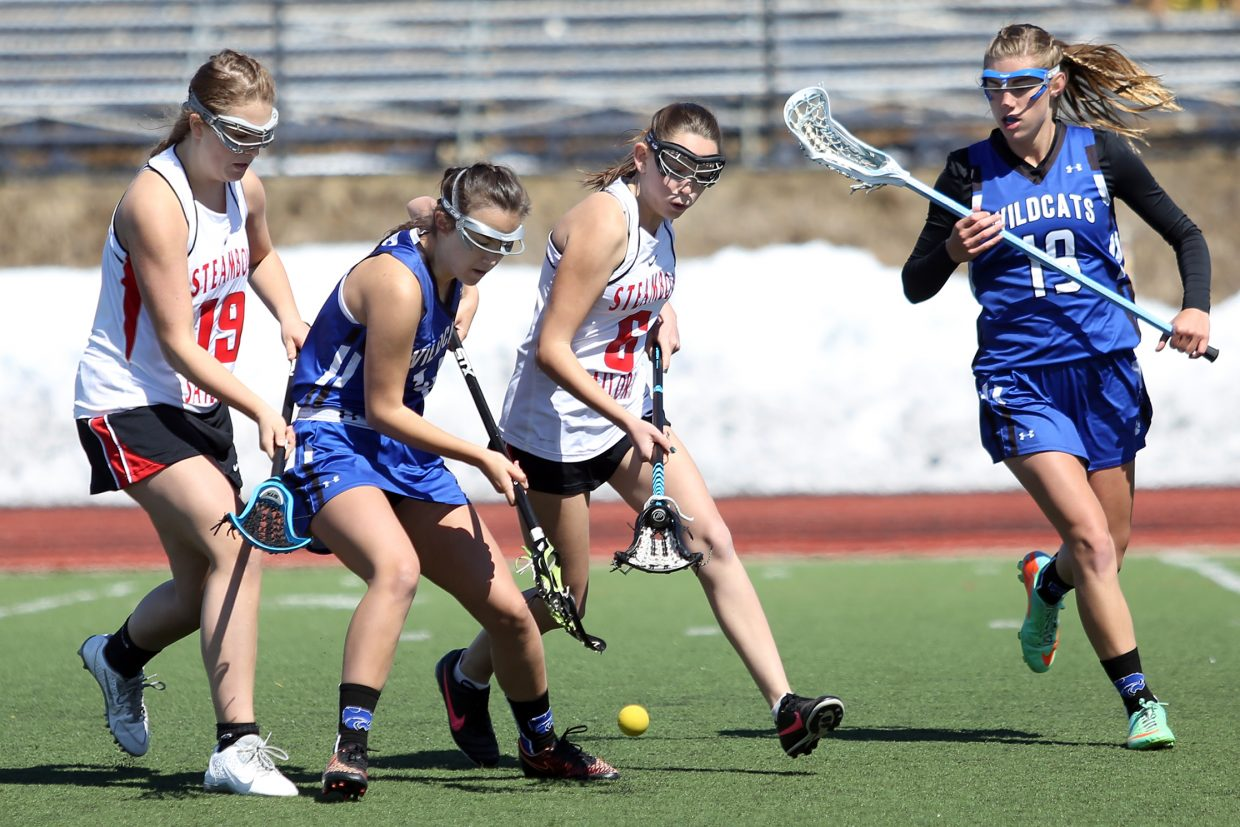 Steamboat Springs freshmen Anna Nell, far left, and Bailey Gander, middle right, chase down a loose ball Saturday against Fruita Monument at Gardner Field. The Sailors pulled the upset, winning 9-7.