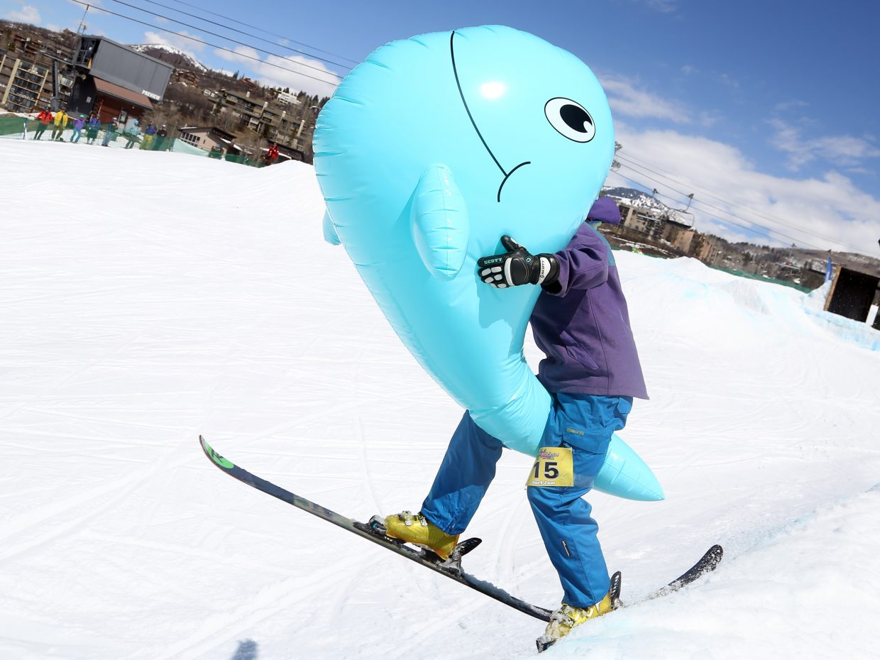 Justin Dillie attempts to use an inflatable whale to score bonus points with the judges Sunday during the Toes on the Nose Surf Jam, part of Springalicious 2016 at the Steamboat Ski Area.