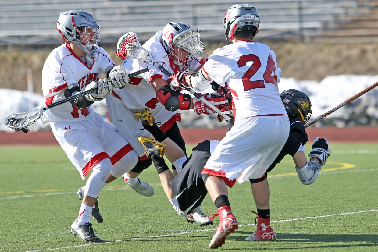 Steamboat Springs senior Joe DeLine, center, plows through a Thompson Valley player on Wednesday at Gardner Field.