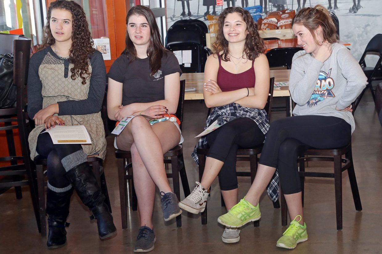 From left, Steamboat Springs High School girls' golf team members Amanda Perlman, Este Wilkinson, Sarah Heineke and Riley Toye listen to a talk given by Natural Grocers' Alicia McLeod on Thursday.