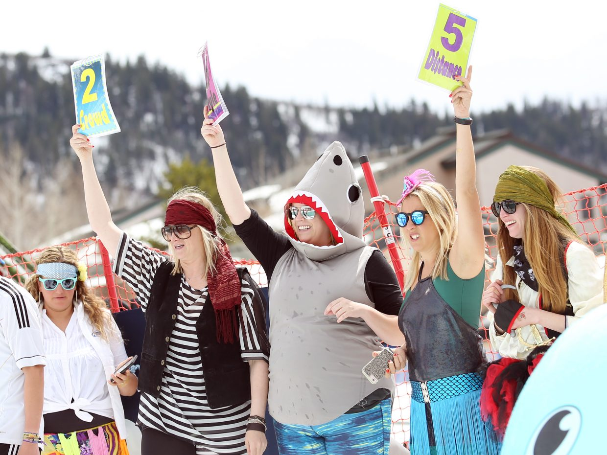 The judges flash their scores after a competitor's run Sunday at the Splashdown Pond Skim at Steamboat Ski Area.