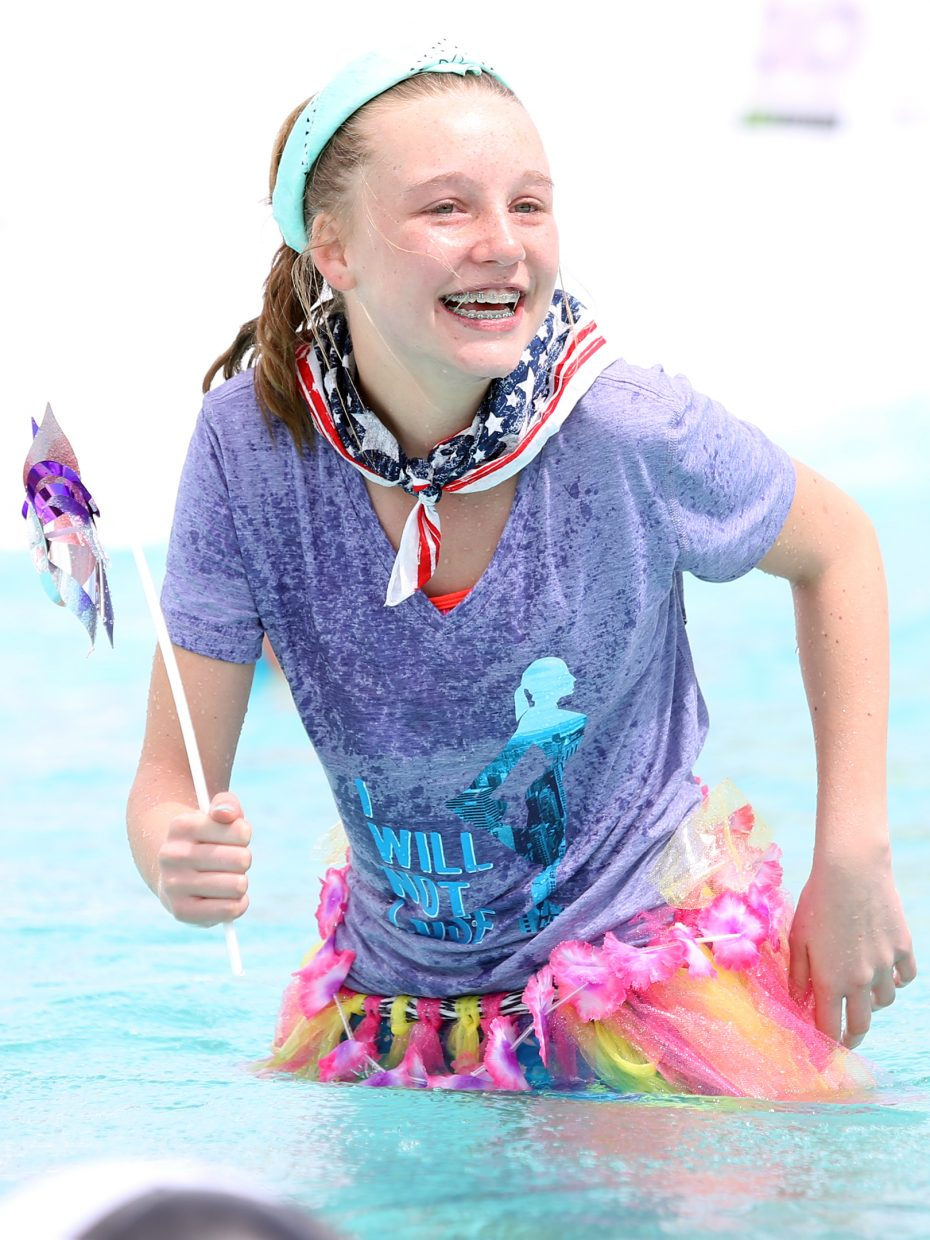 Cecilia Knapp laughs after coming up short during her run Sunday at the Splashdown Pond Skim at Steamboat Ski Area.