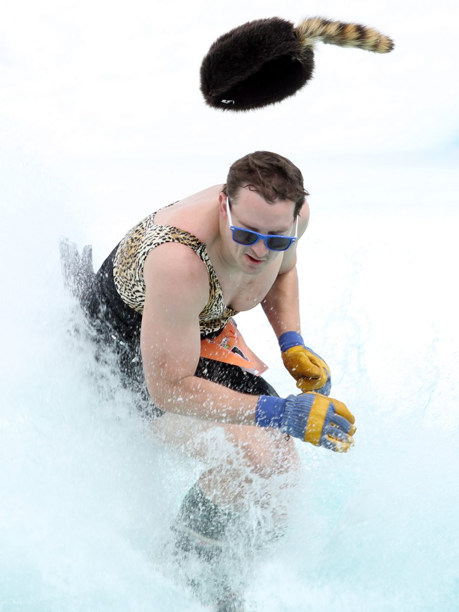 """Chris McKinney, or """"Clown Baby,"""" loses his cap Sunday during his ran at the Splashdown Pond Skim at Steamboat Ski Area."""