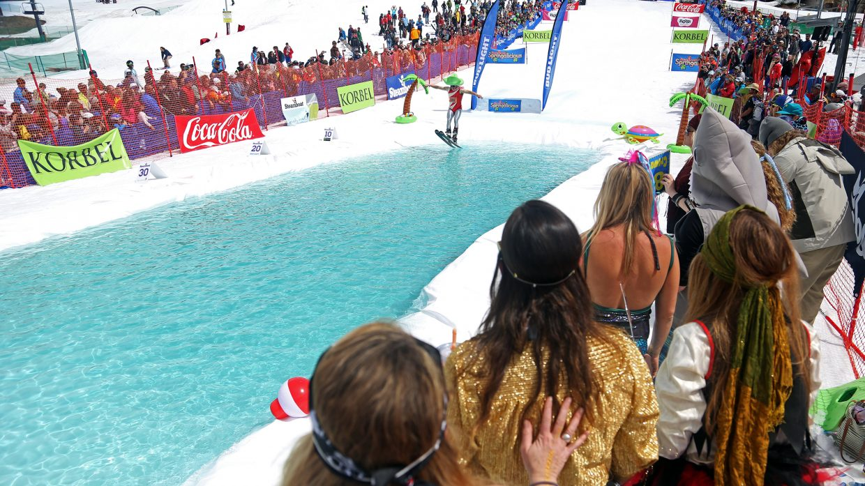 The judges look on during a competitor's run Sunday at the Splashdown Pond Skim at Steamboat Ski Area.