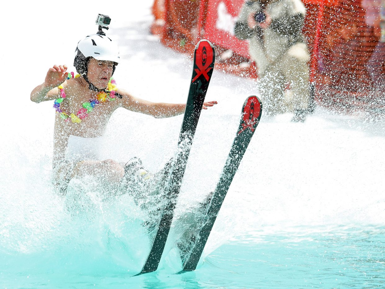 Colton Littlewood hits the water Sunday during his run at the Splashdown Pond Skim at Steamboat Ski Area.