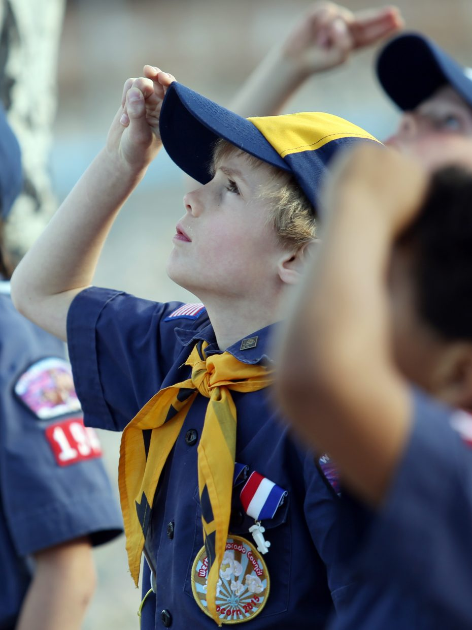 Steamboat Springs Cub Scout Pack 194's Jackson Sloop, a Wolf Scout, salutes the American flag as it's raised during Wednesday's ceremony outside the middle school.
