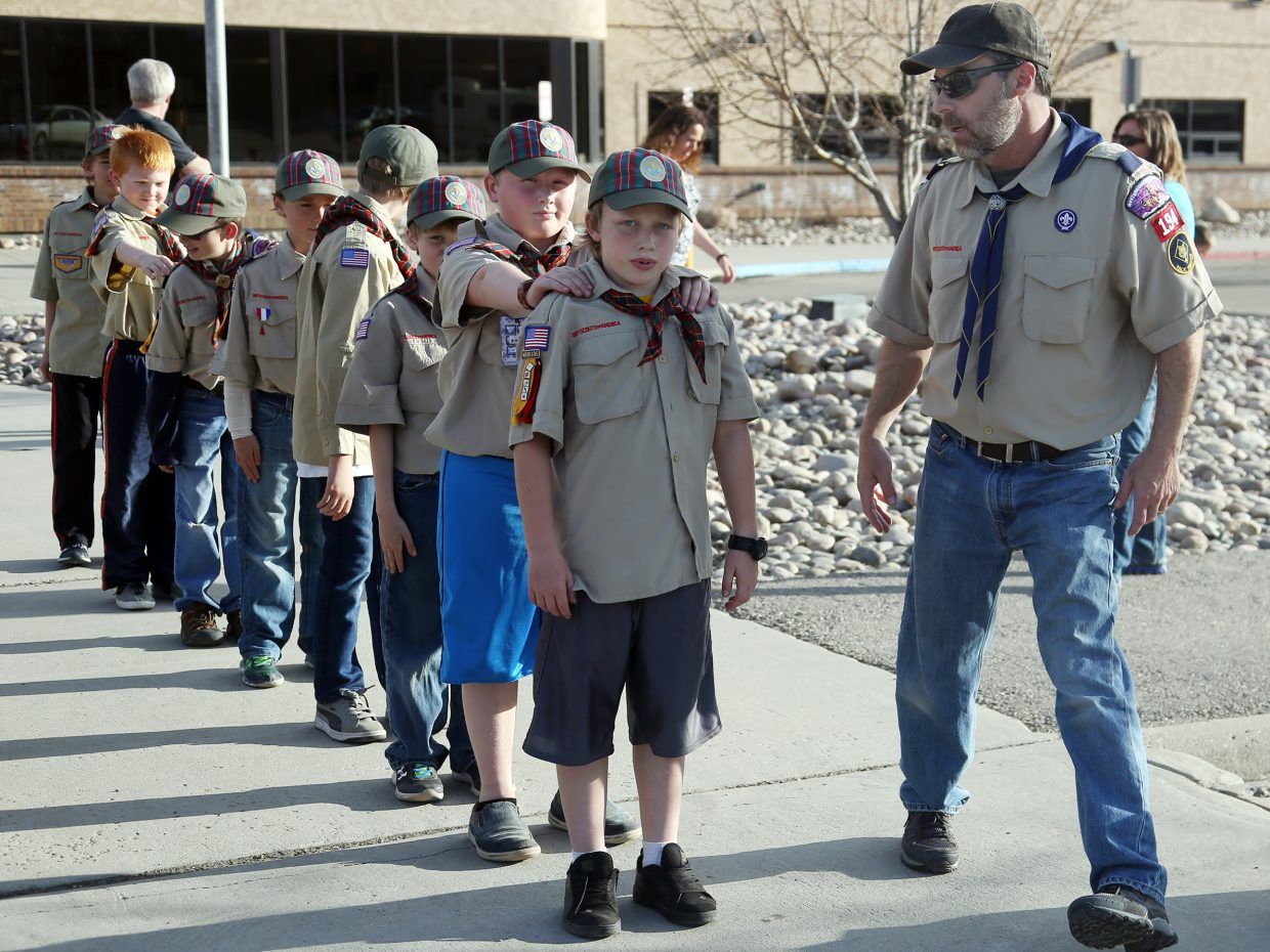 Steamboat Springs Cub Scout Pack 194 leader Ken Mauldin organizes the scouts during a practice run prior to Wednesday's flag ceremony outside the middle school.