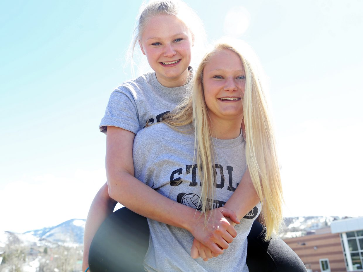 Steamboat Springs High School seniors Maritza (bottom) and Abigail Wiedel, who are identical twins, on Wednesday both signed to play volleyball at St. Olaf College in Minnesota next season.