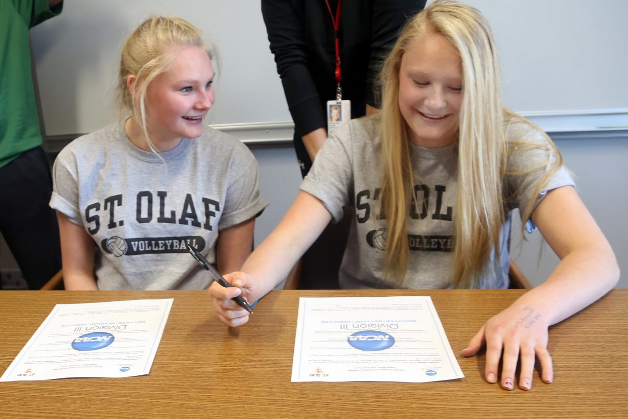 Abigail Wiedel, left, looks at her twin sister Maritza Wiedel as she signs her letter of intent Wednesday at Steamboat Springs High School. Both girls will play volleyball at St. Olaf College in Minnesota.