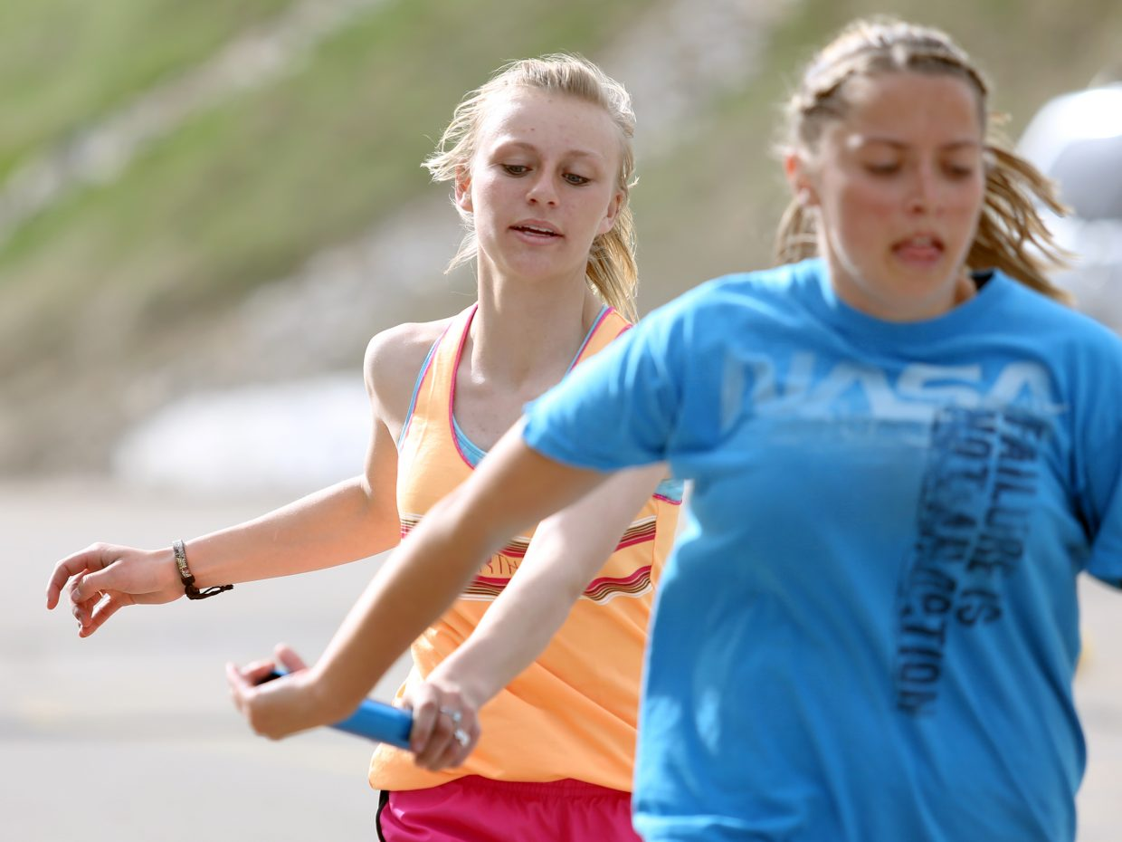 Soroco High School junior Morgan George, left, practices relay handoffs with junior DaKota Bruner on Thursday in Oak Creek. The girls' relay teams are a strong point for the Rams again this season.