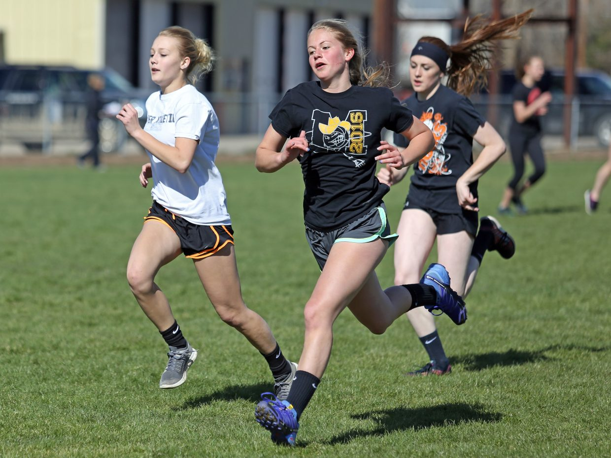 From left, Tiger freshman Paige Barnes, freshman Allison Ingols and junior Darian Murphy — a first-year track athlete — run sprints during track practice Wednesday at Hayden High School.
