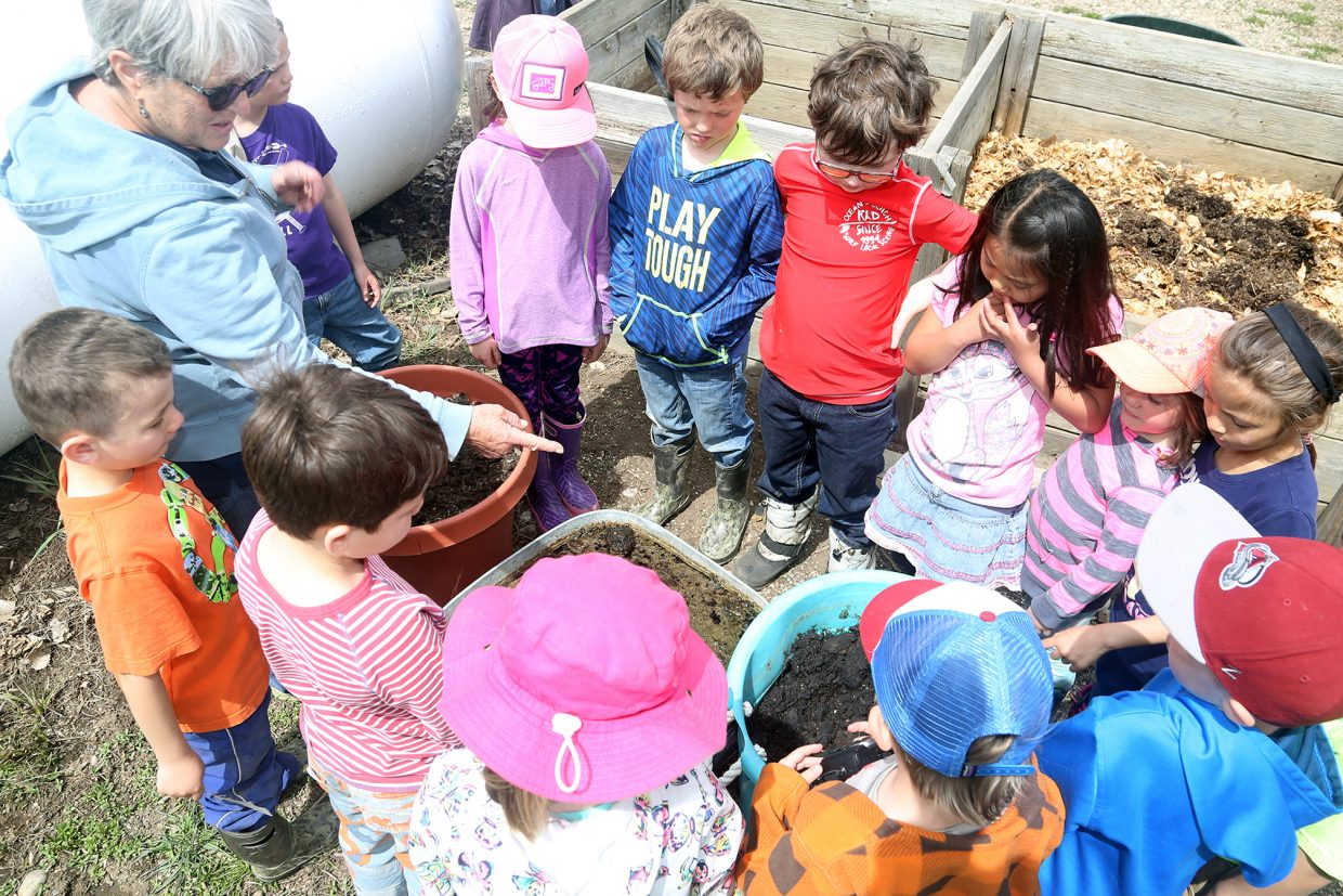 The Nature Conservancy's Betsy Blakeslee, left, talks to the elementary school students about creating good soil for gardening Friday at Carpenter Ranch.