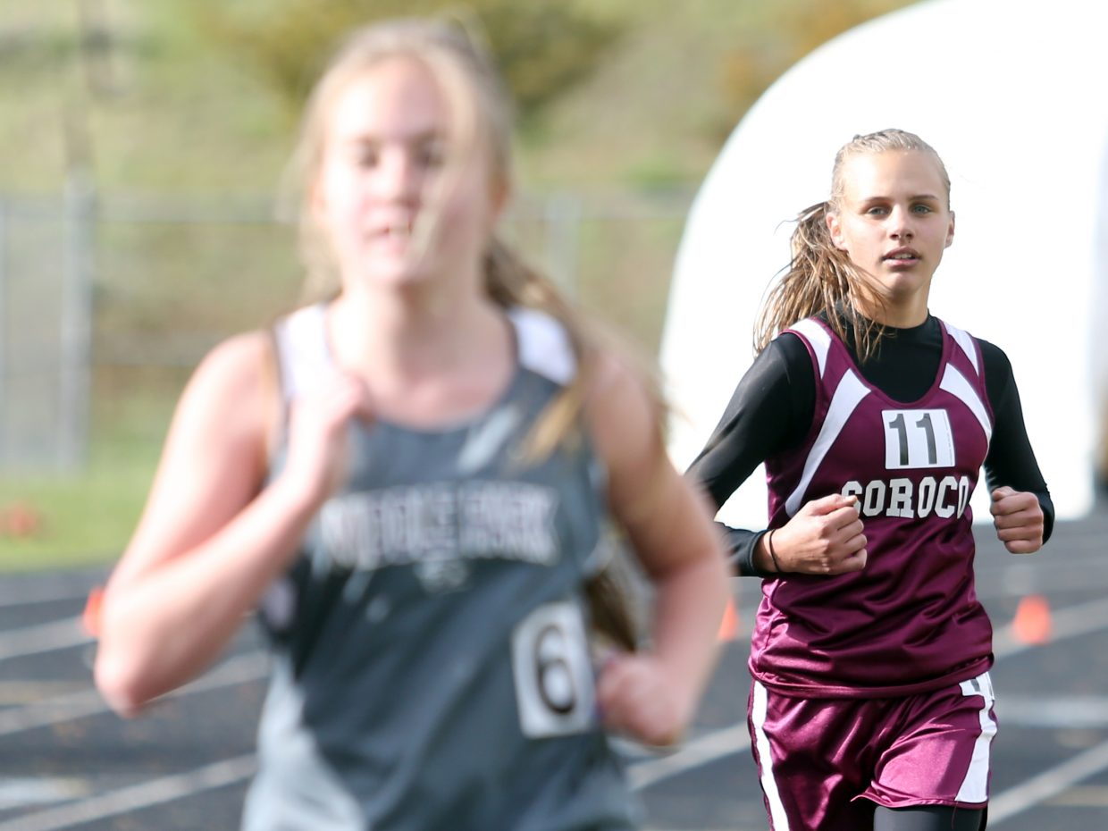 Soroco High school freshman Chloe Veilleux, right, competes in the girls' 3,200-meter race at a meet in Craig earlier this season.