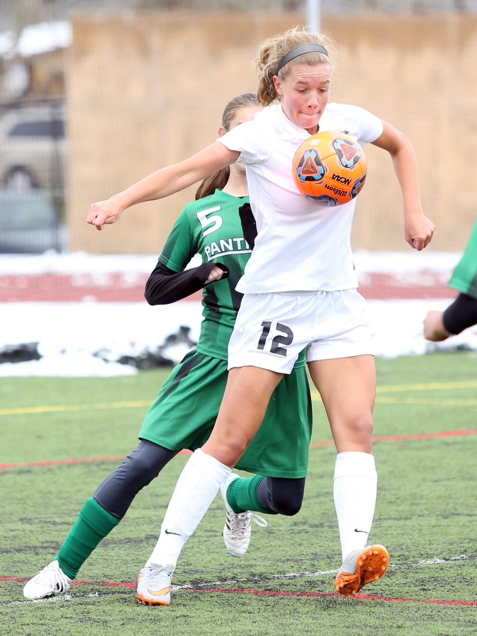 Steamboat Springs senior Natalie Bohlmann uses her body to control the ball against Delta on Saturday at Gardner Field.