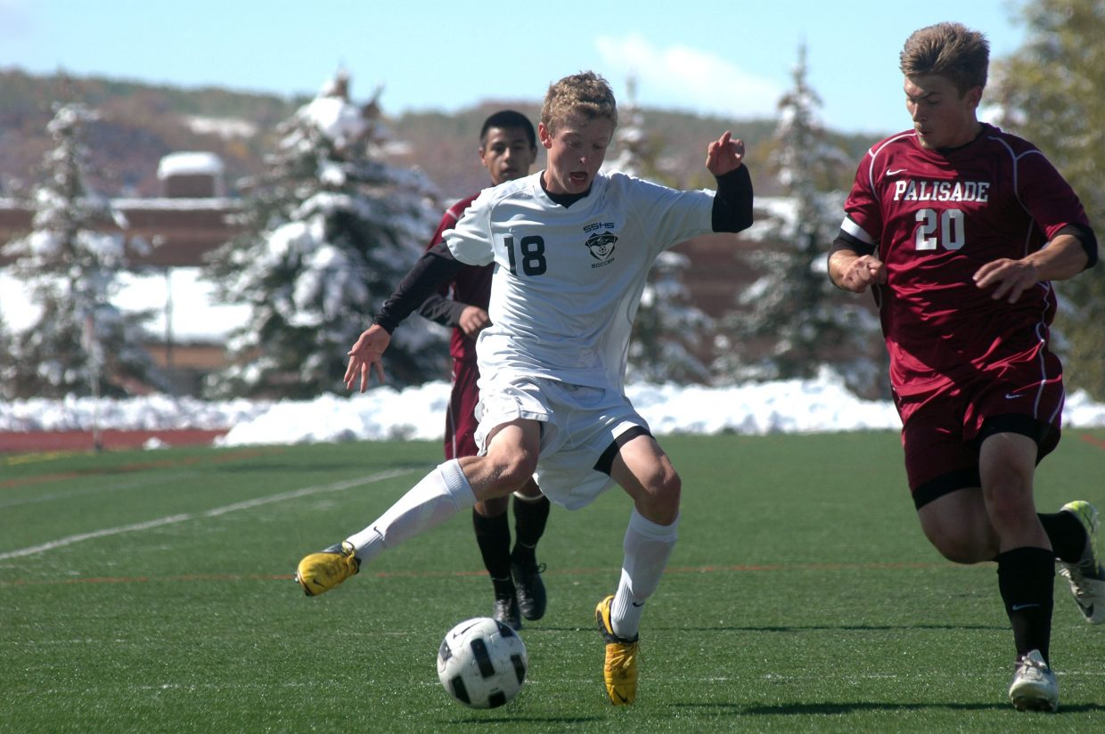 Charlie Beurskens tries to elude Palisade's Daniel Kachin in the first half of Steamboat's 6-0 win against Palisade on Saturday afternoon.