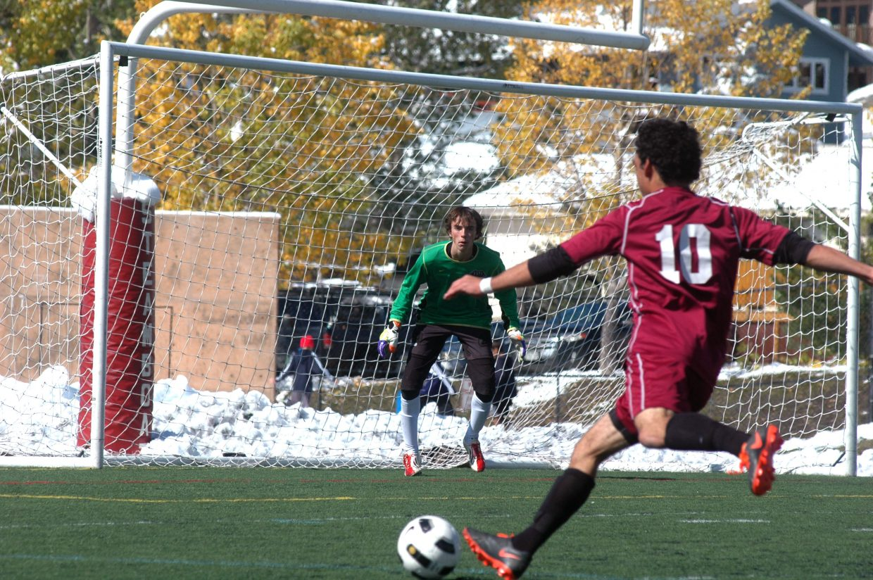 Steamboat keeper Jake Andersen, who had eight tremendous saves, tries to keep Palisade's Marques Combs from scoring in the first half of the Sailors' 6-0 win Saturday afternoon.
