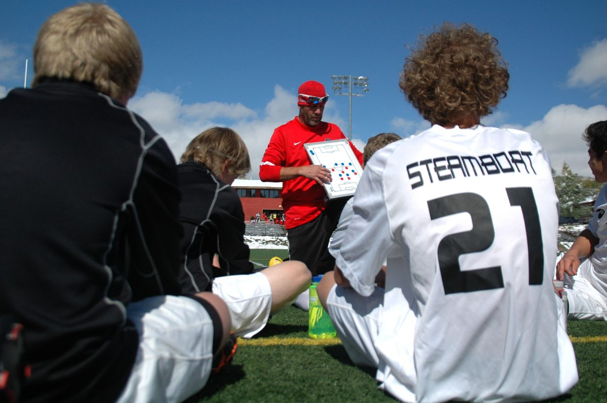 Steamboat coach Rob Bohlmann explains second-half strategy during halftime of Saturday's 6-0 win against Palisade.