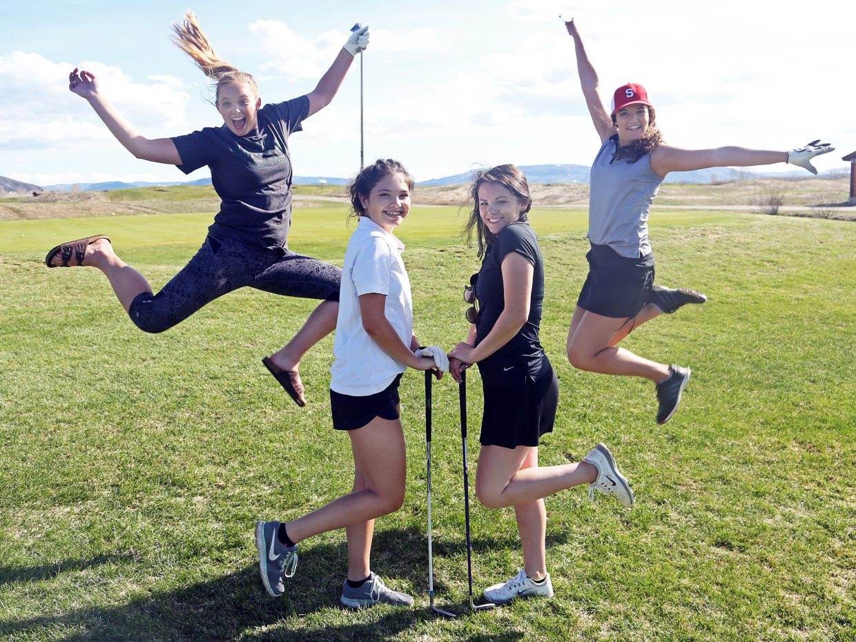From left, Jenna Miller, Sarah Heineke, Kellyn Stanhope and Amanda Perlman get playful for a photo shoot Wednesday at Haymaker Golf Course. The girls will represent Steamboat Springs High School in the Sailors' regional golf tournament Saturday in Craig.