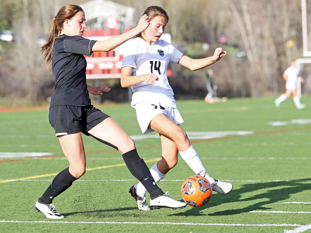 Steamboat Springs freshman Megan Salyer, right, attempts to steal the ball away from an Eagle Valley player Thursday at Gardner Field.