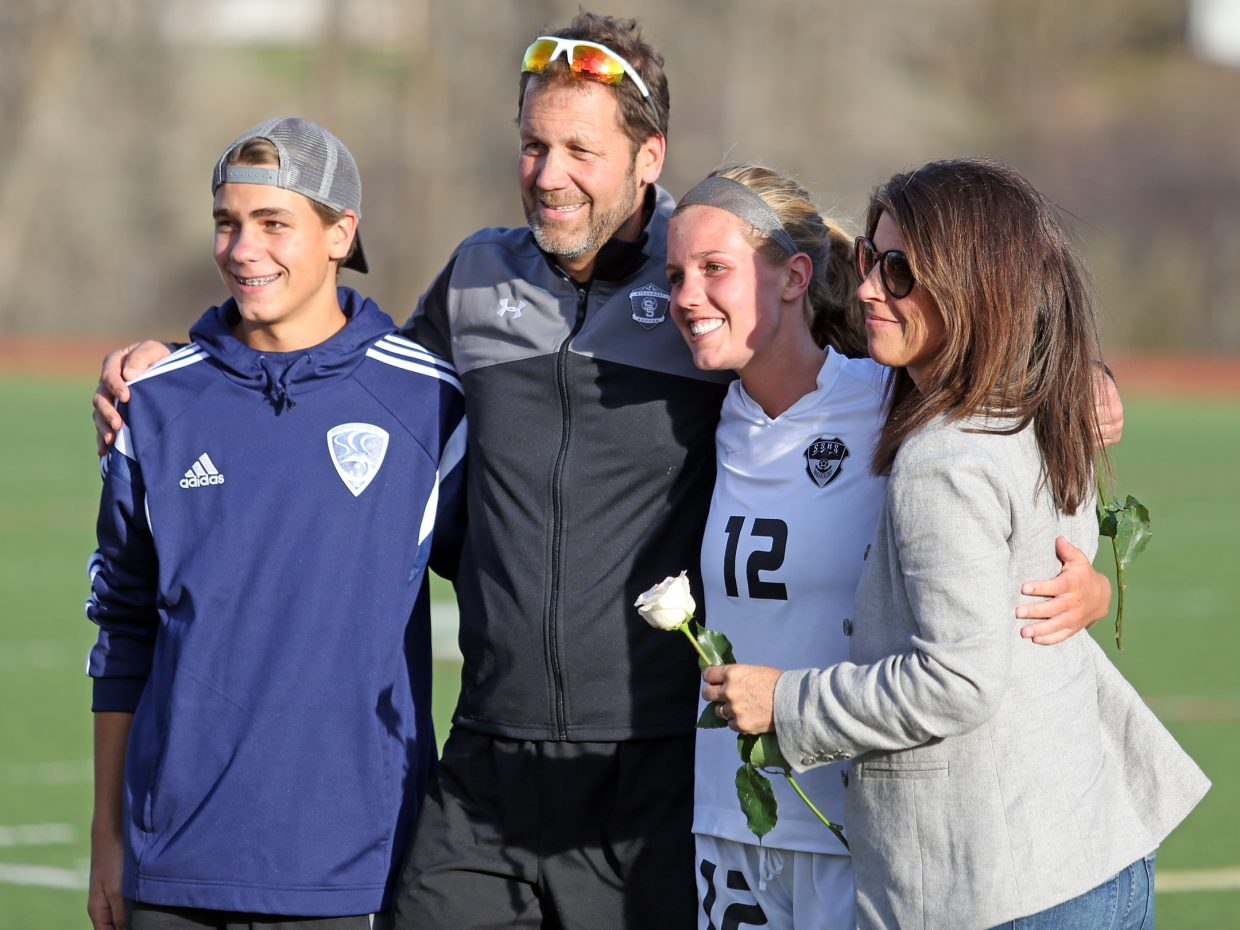 The Bohlmann family, with SSHS soccer coach Rob Bohlmann, middle left, and senior Natalie Bohlmann, middle right, grab a picture during the senior day celebration at halftime of Thursday's game against Eagle Valley at Gardner Field.