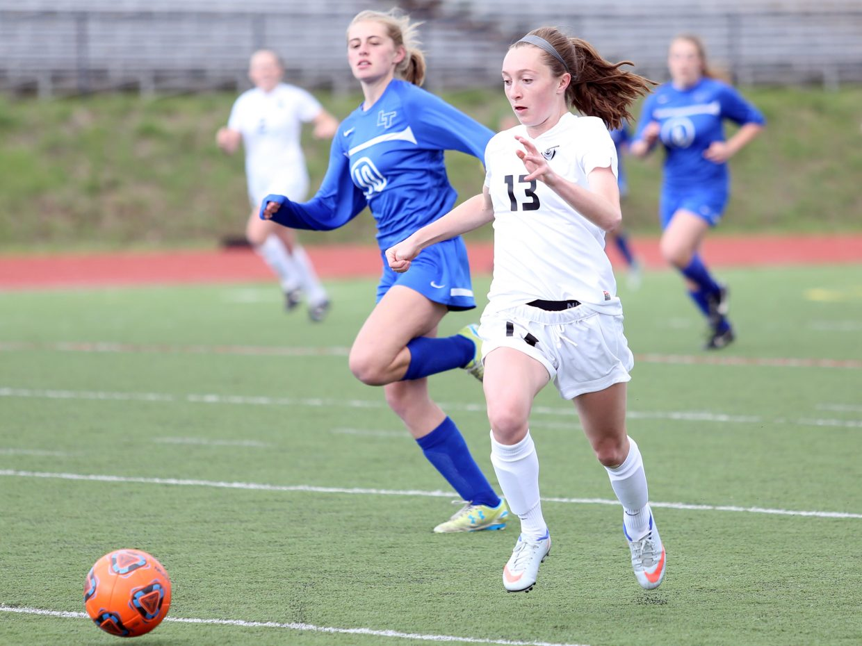Steamboat Springs senior MacKenzie Gansmann, right, races into position for an early score against Longmont on Wednesday at Gardner Field. The Sailors won 6-1 in their first-round playoff game.