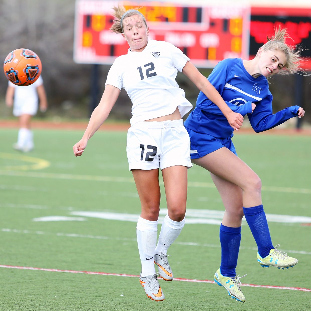 Steamboat senior Natalie Bohlmann, left, competes with a Longmont player for possession Wednesday at Gardner Field.