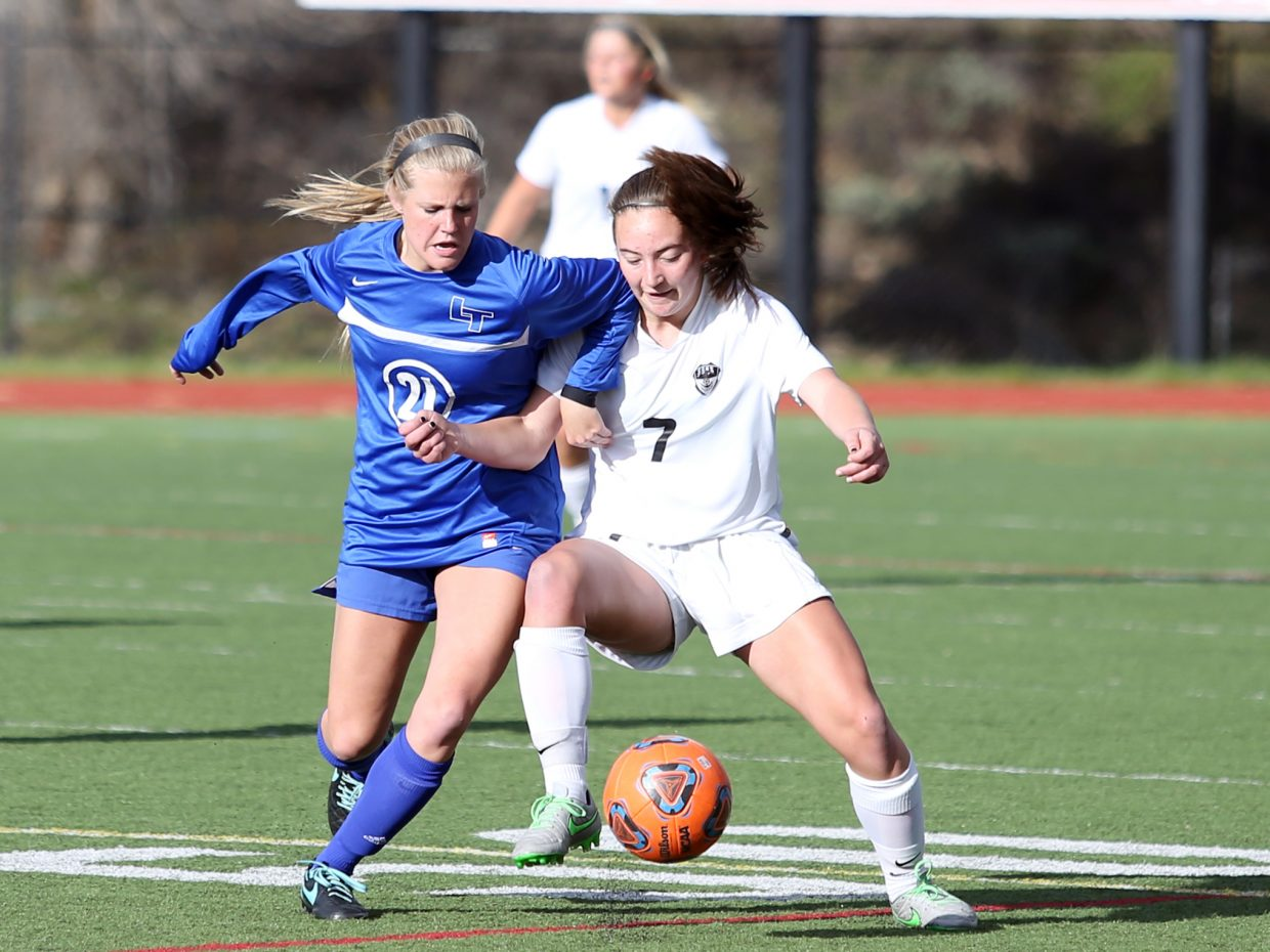 Steamboat sophomore Keelan Vargas, right, and Longmont's Sam Wiley battle for possession Wednesday at Gardner Field.