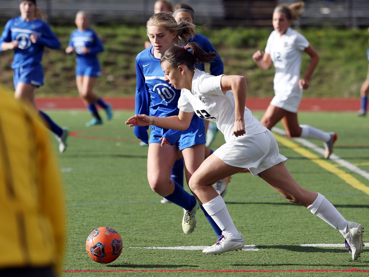 Steamboat's Lilli Sage Turton looks to move past her defender Wednesday against Longmont.
