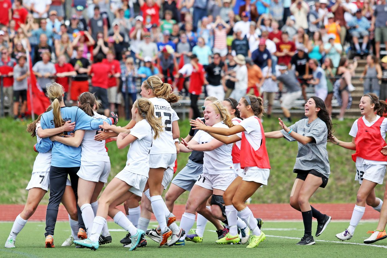 Players rush senior goalkeeper Ocoee Wilson moments after the Steamboat Springs High School girls soccer team defeated visiting Silver Creek in penalty kicks to advance to the Class 4A state quarterfinals.