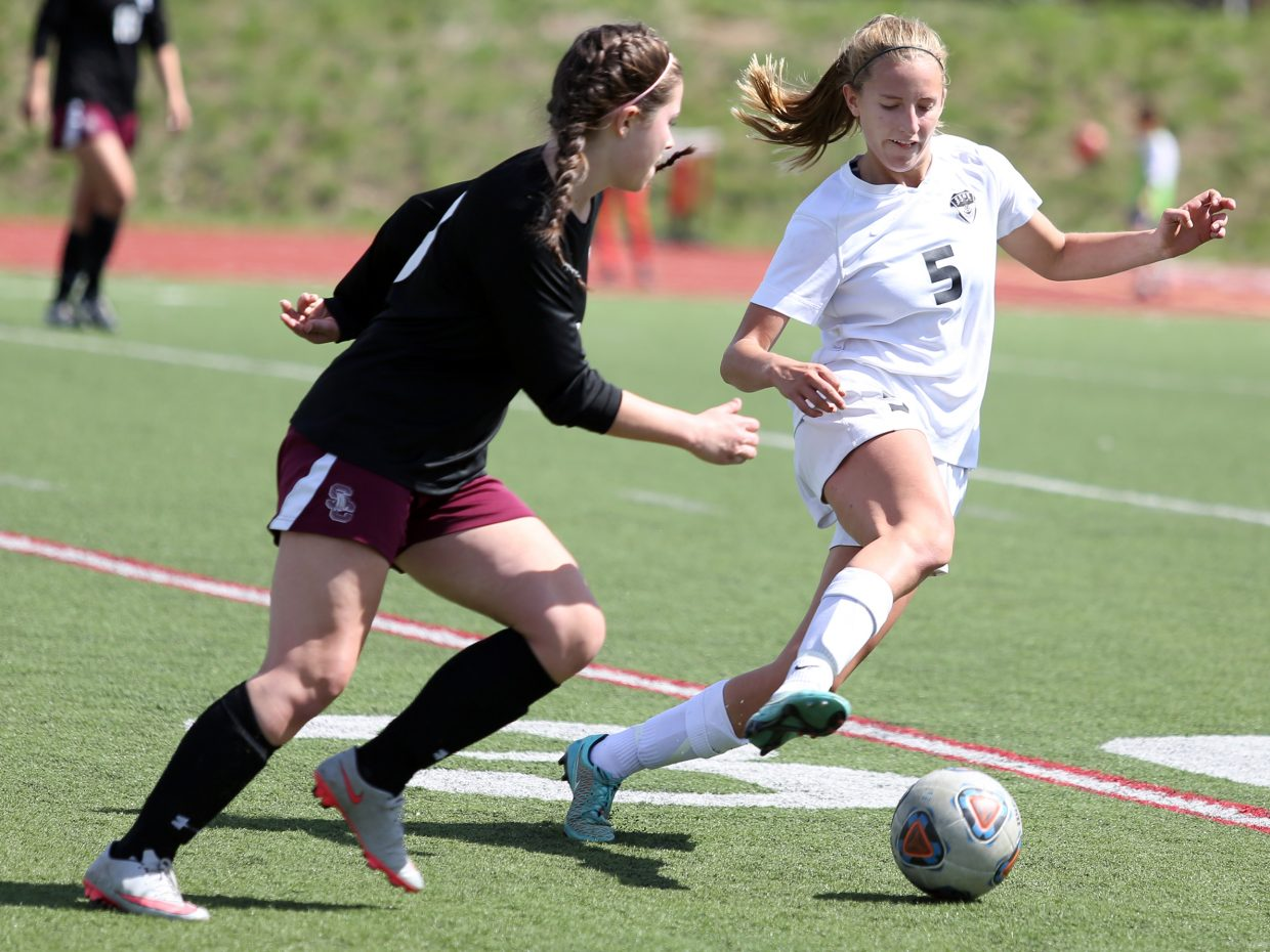 Steamboat junior Brooke Buchanan, right, looks to steal the ball away from a Silver Creek player Saturday at Gardner Field.