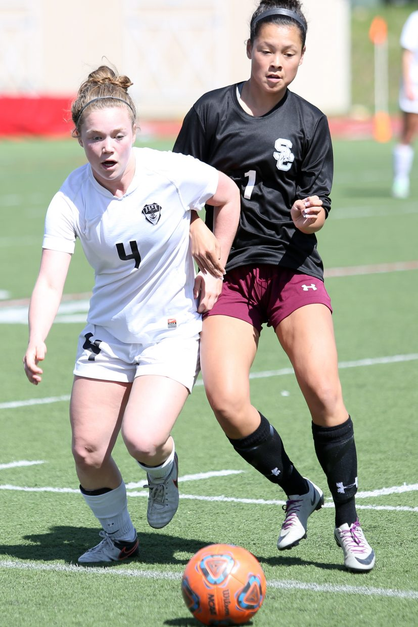 Steamboat senior Logan Sankey, left, and Silver Creek's Maddie Kim fight for the ball Saturday at Gardner Field.