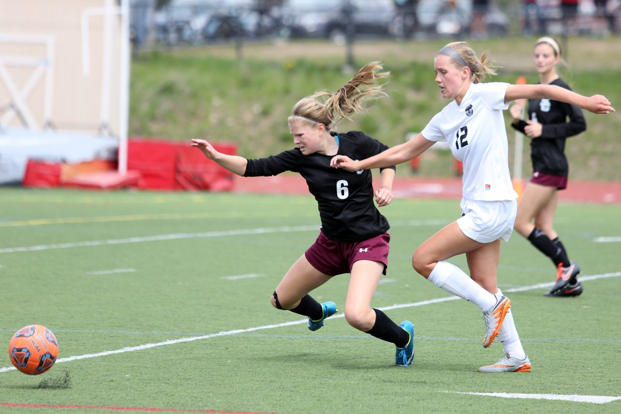 Steamboat senior Natalie Bohlmann, right, and Silver Creek's Emily Reitz chase down a loose ball Saturday at Gardner Field.