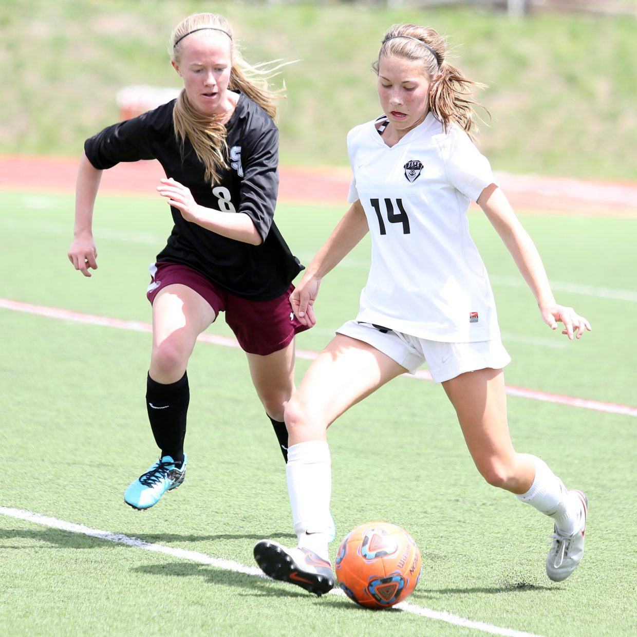 Steamboat freshman Megan Salyer, right, looks to move the ball upfield Saturday against Silver Creek at Gardner Field.