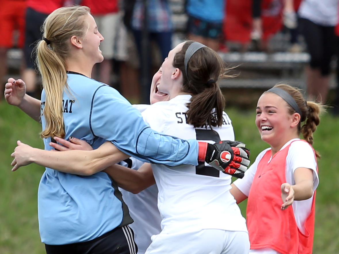 Players greet SSHS goalie Ocoee Wilson, left, after the Sailors defeated Silver Creek on Saturday at Gardner Field.