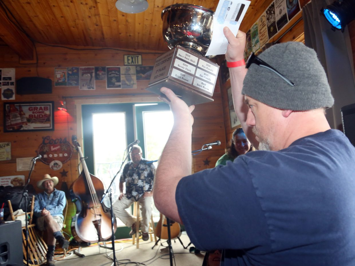 North Routt's Jeff Fegelein holds up his trophy after he won first place in the red chili category of Sunday's Great North Routt Chili Cook Off at Hahn's Peak Roadhouse.