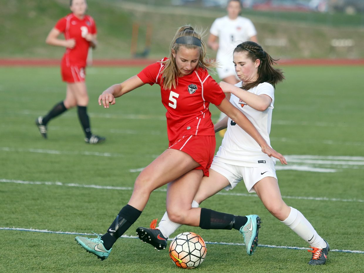 Steamboat junior Brooke Buchanan, left, fights for possession against Lewis-Palmer Thursday in Monument.