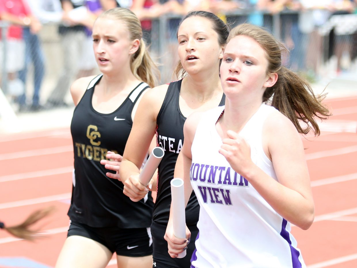Steamboat Springs senior Alexandra Tumminello, center, competes in the girls 4x800-meter relay race at the state track meet Thursday in Lakewood.