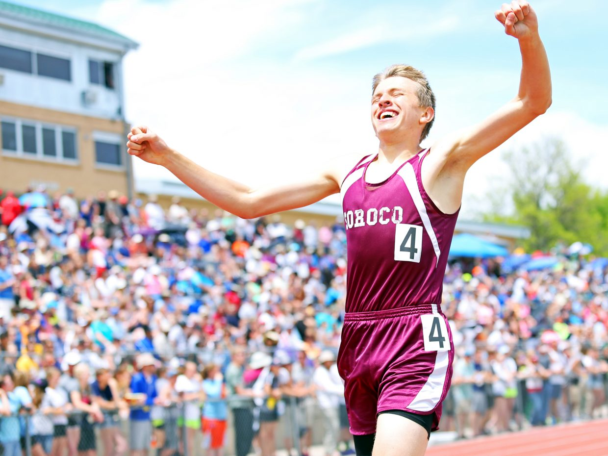 Soroco High School sophomore Ben Kelley raises his arms in triumph after crossing the finish line to win the Class 2A boys 800-meter race Friday at Jeffco Stadium in Lakewood. Kelley's time of 1:55.61 set both a school and state meet record.