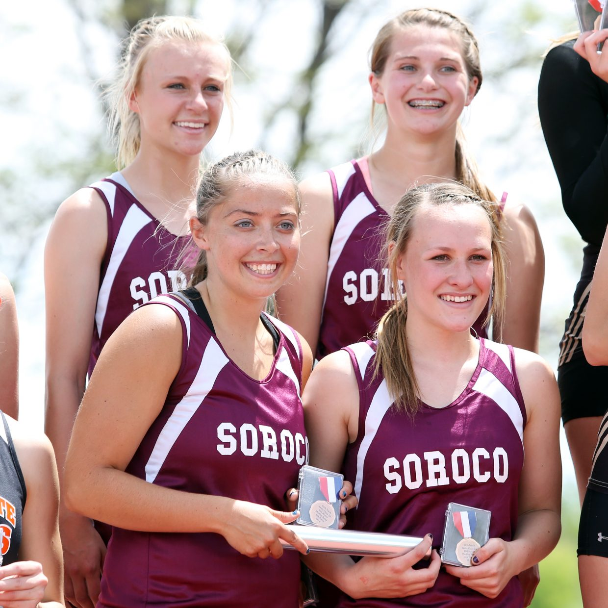 Clockwise from top left, Soroco's Morgan George, Mattie Rossi, Cassie Constine and DaKota Bruner stand on the podium after taking sixth in the girls 800-meter sprint medley relay at the state track meet Friday in Lakewood.