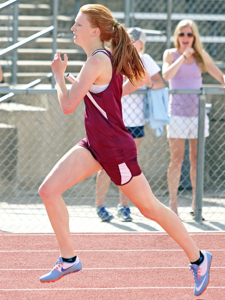 Soroco senior Lucy Carlson competes in the girls 4x400-meter relay Friday at the state meet in Lakewood.