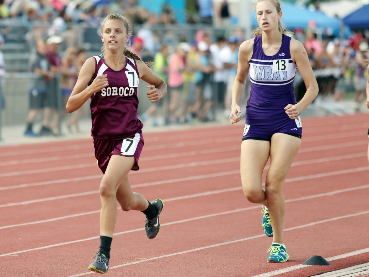 Soroco freshman Chloe Veilleux, left, competes in the 2A girls 1,600-meter race Saturday at the state track meet in Lakewood. She finished fifth and broke the school record.